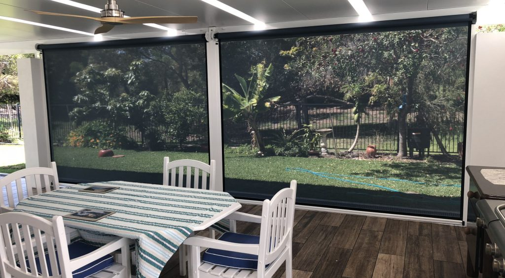 looking out through ziptrak patio awnings in pelican waters