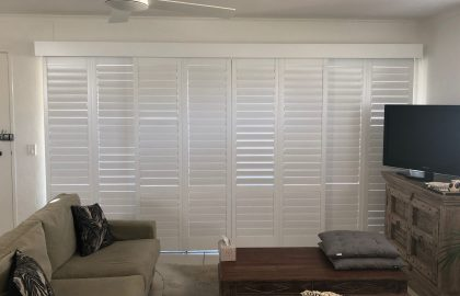 sliding plantation shutters in living room at noosa