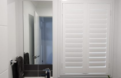 white shutter in bathroom at parrearra